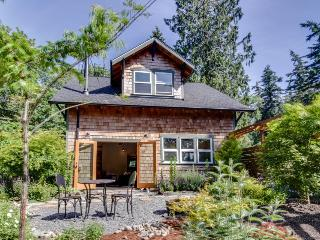 Art-filled retreat surrounded by trees & gardens, almost an acre of land!