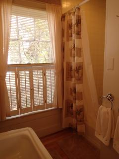 There is a nice window right next to the shower, for a breeze to come in and air the room.
