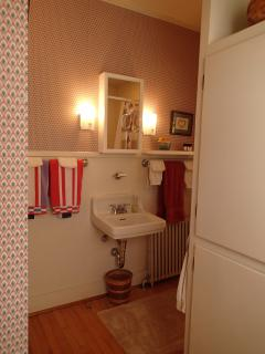 The 1st floor bathroom is well-lit and has lots of things you may have forgotten in the cupboards!