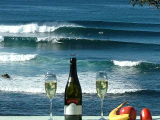 Relax on your private deck & enjoy champagne watching the surfers master the reef break at Mollymook