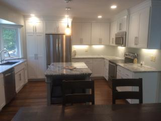 Modern cabinetry w/granite tops and new stainless appliances