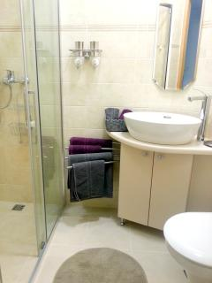 bathroom features heated floor and walk in shower