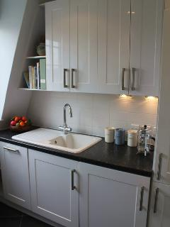 The 'galley' kitchen has integral appliances