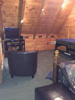 Loft area with queen size bed, 32 inch HDTV, Wi Game, lots of dvd movies and 4-in-1 game table.