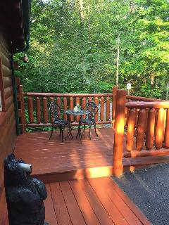The front deck at our cabin with a bistro set for enjoying your morning coffee.