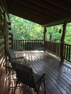 The back deck is so relaxing to either sit on the porch swing or sit in the hot tub and enjoy nature
