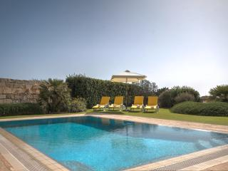 Private pool deck with sun loungers and umbrellas