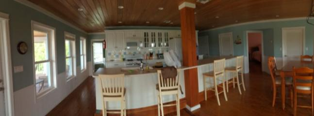 Panorama of kitchen and living room with dining / game table