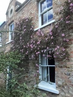The coach house apartment seen from its secluded courtyard.