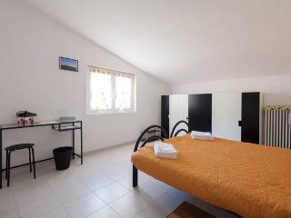 Camera doppia Beige con letto matrimoniale