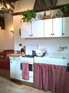 TOWER APT kitchen/sittingroom openspace,equipped with cooking essentials to prepare delectable meals