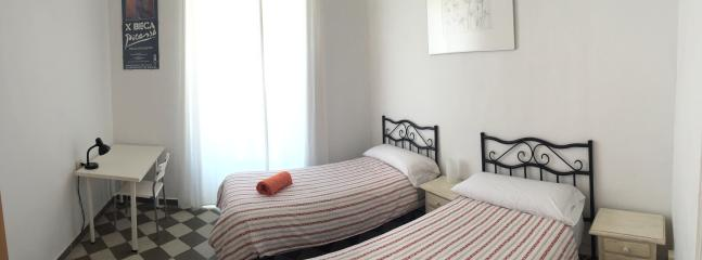 Bedroom with two singles beds.Views to Picasso area, Plaza de la Merced and Alcazaba