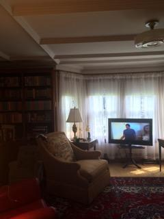 Living room with bay windows, television, and WiFi