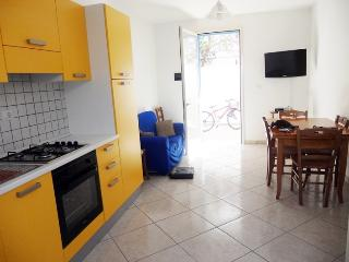 Yellow holiday house in Torre Pali in Salento Apulia about 600 meters from the s