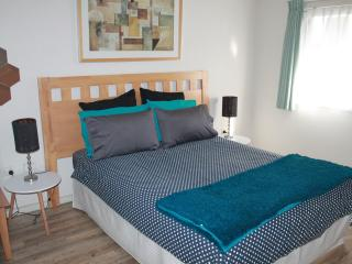 Spacious bedroom with comfortable bed. Sofa bed in living room. Cot available