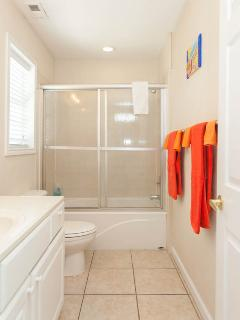 Guest Quarters Full Bath with Tub/Shower Enclosure on Ground Level