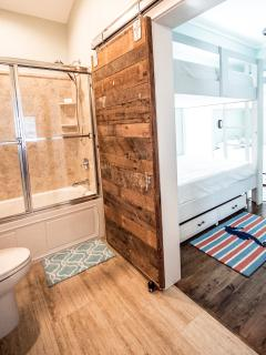 3rd floor kid-friendly Tub/Combo connects to Queen bunk room & opens to Living room/Wet bar area