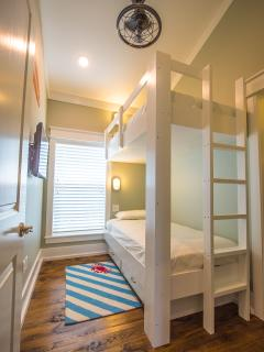 Kids twin bunk room, TV and shared bath on 3rd floor gives them their own fun kid space.