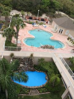 Pool with hot tub (extreme left rear) hidden by Palm tree,  grill area with picnic tables in back .