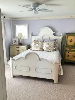 Master bedroom with queen bed and attached bath on main level