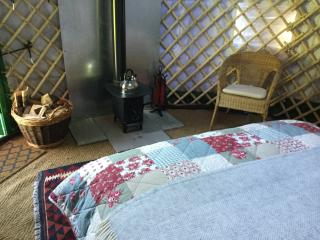 Wood burning stove, keeps the yurt cosy, even in winter. Kettle, tea, water all provided. Logs too