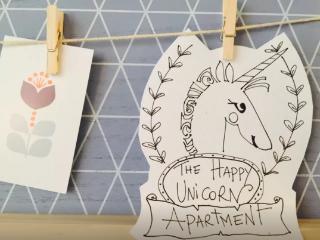 The Happy Unicorn logo