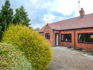 THE PADDOCK, all ground floor, woodburning stove, en-suite, on-site golf, York