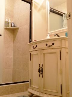 Bathroom sink and mirror view.