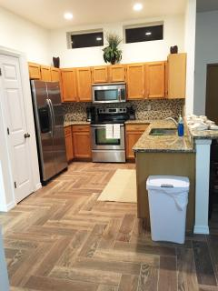 updated open kitchen stainless appliances, pantry, indoor laundry, bar seating for 3 fully stocked