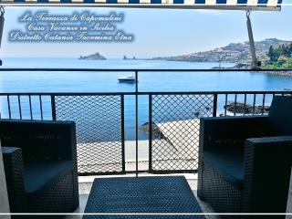 """THE TERRACE OF CAPOMULINI"" Holiday House Seafront Best view at the feet of Etna"