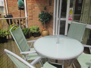 This is quite a sun trap. There is seating for six. A storage box on the patio contains more seating