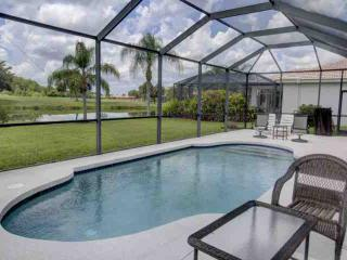 4 bedroom pool home in gated golf community
