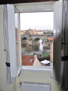 Direct view from dining room window onto Charles Bridge