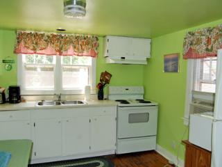 Fully functional and stocked pretty lime green kitchen