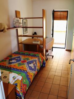 Habitación con salida a balcón