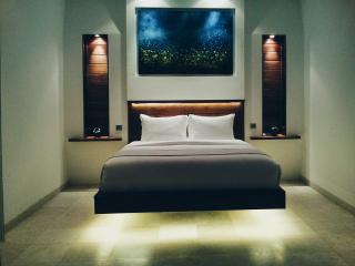 Stunning 'floating' king bed