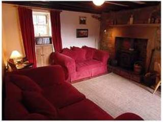 Comfortable lounge with TV, Internet access, log burner and dining table