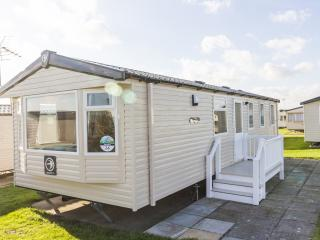 Ref 80016 Fairways 8 berth caravan at Haven Hopton on sea Close to the beach.