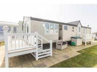Ref 80010  Horizons Stunning caravan with a full sea view and decking.