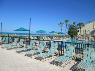 There are plenty of chairs on the pool deck for lounging and listening to the waves.