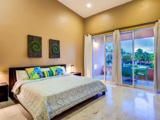 Master bedroom and balcony overlooking the lagoon
