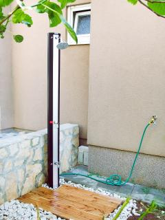 Private solar shower in garden