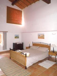 Master bedroom, formally a barn, reaching 7m into the wooden rafters.