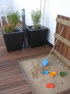 sand box for kids in the coutyard