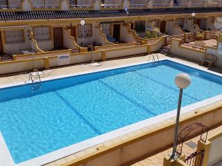 Town house overlooking communal pool, Punta Prima