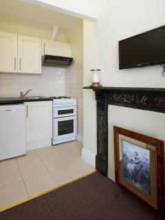 Brendan Behan kitchen and wall mounted TV with cable TV