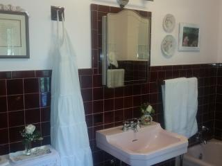 Bath has double sinks, tub, and shower. Travel sized toiletries provided