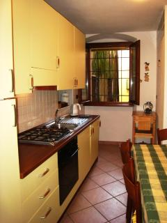 Fully fitted kitchen with dishwasher, and dining table for six, with kitchen window