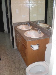 Double Vanity for quick prepp for husband and Wife:  Granite, Glass Shower doors, nice appointments.