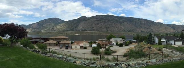 Panoramic views of lake and mountains in quiet dead end neighborhood.